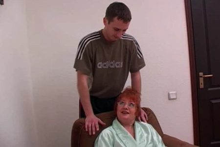 The guy does a back massage to his granny and fucks her hairy vagina.