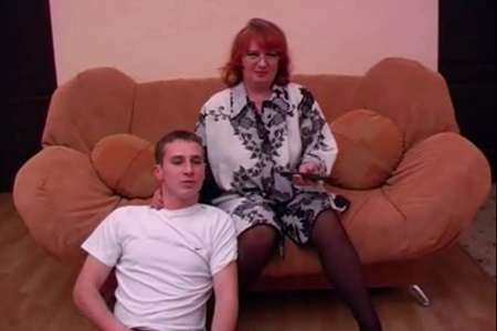 Russian granny watched porn with her grandson and fucked him.